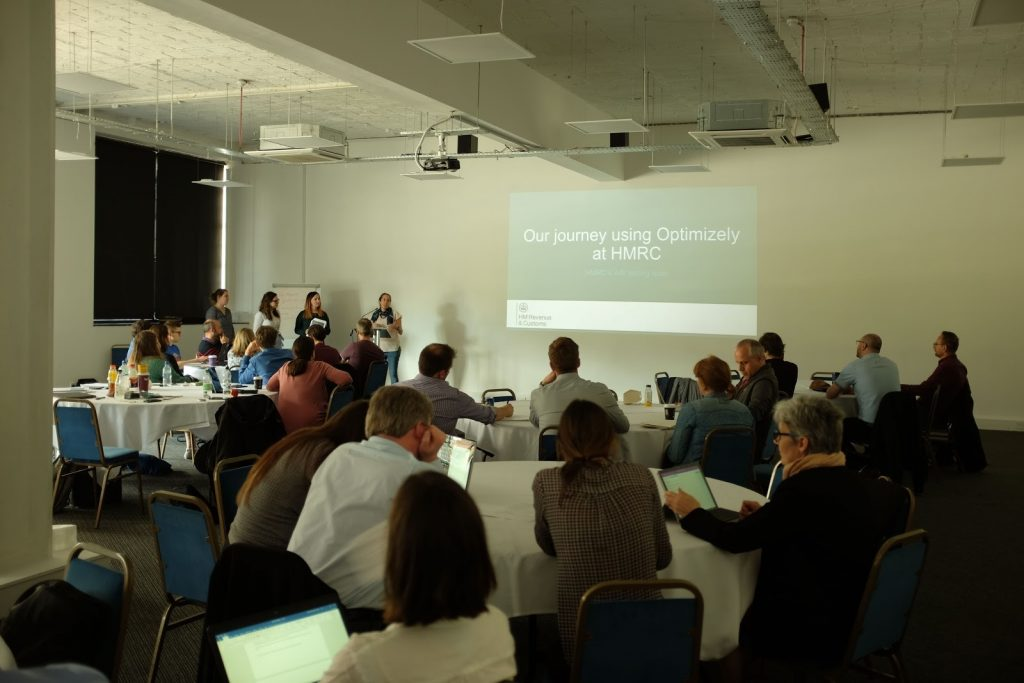 The team talking in front of the audience at the GDS conference