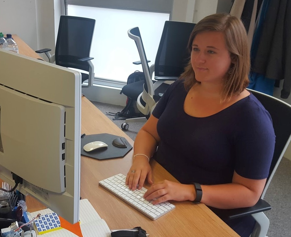 Beccy Stafford HMRC Platform Test Lead sitting at a desk with monitor