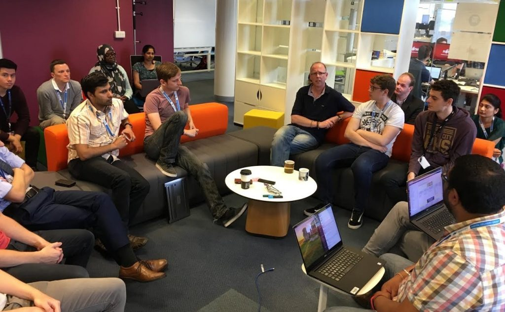 Test community catch up sitting around on comfy chairs in a break out area at our digital delivery centre in Telford