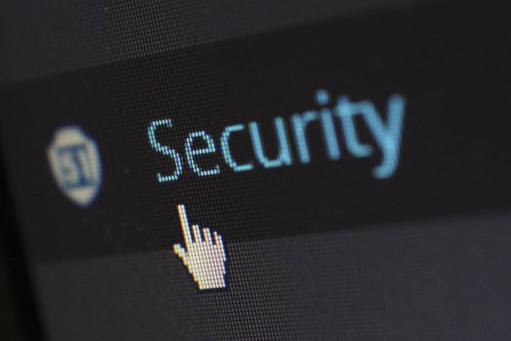 computer image of a hand pointing at the word security