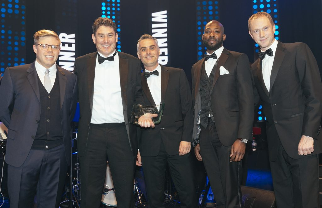 The UK IT Project Team of the Year on stage to collect their award