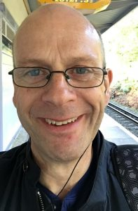 Head image of Andy Ward standing on a railway platform