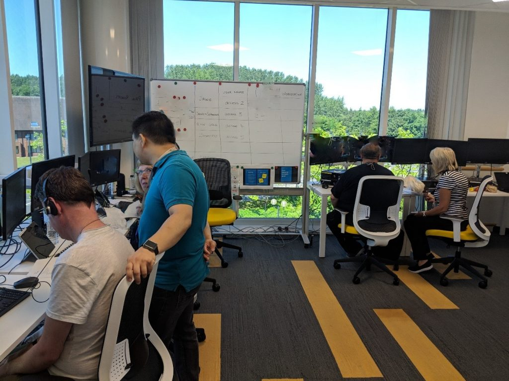 The assistive technology team at work at their desks in the office