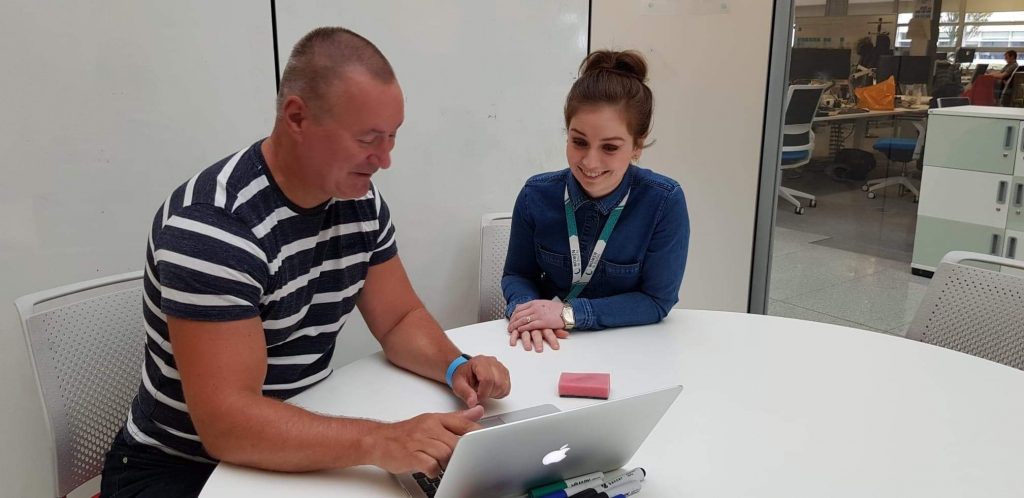 Chloe Walker and her mentor Dave Hatch working together on a laptop