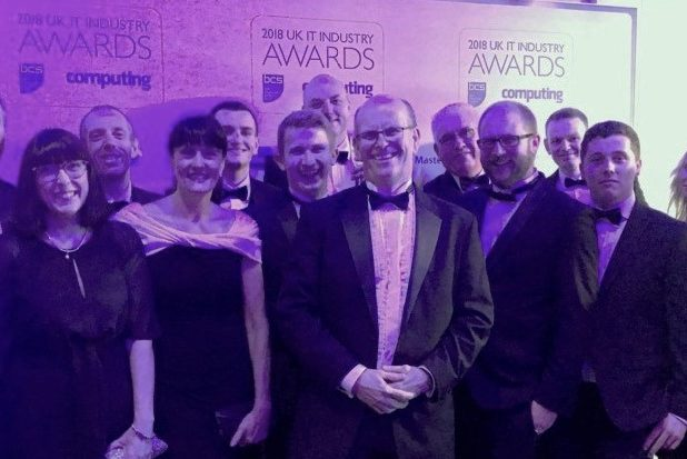 All the HMRC attendees at the UK IT Awards pose for a group shot. They are wearing evening dress