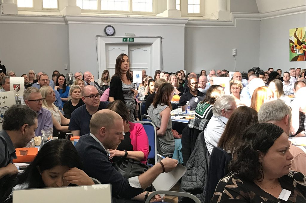 Samantha Taylor standing up at a conference asking a question