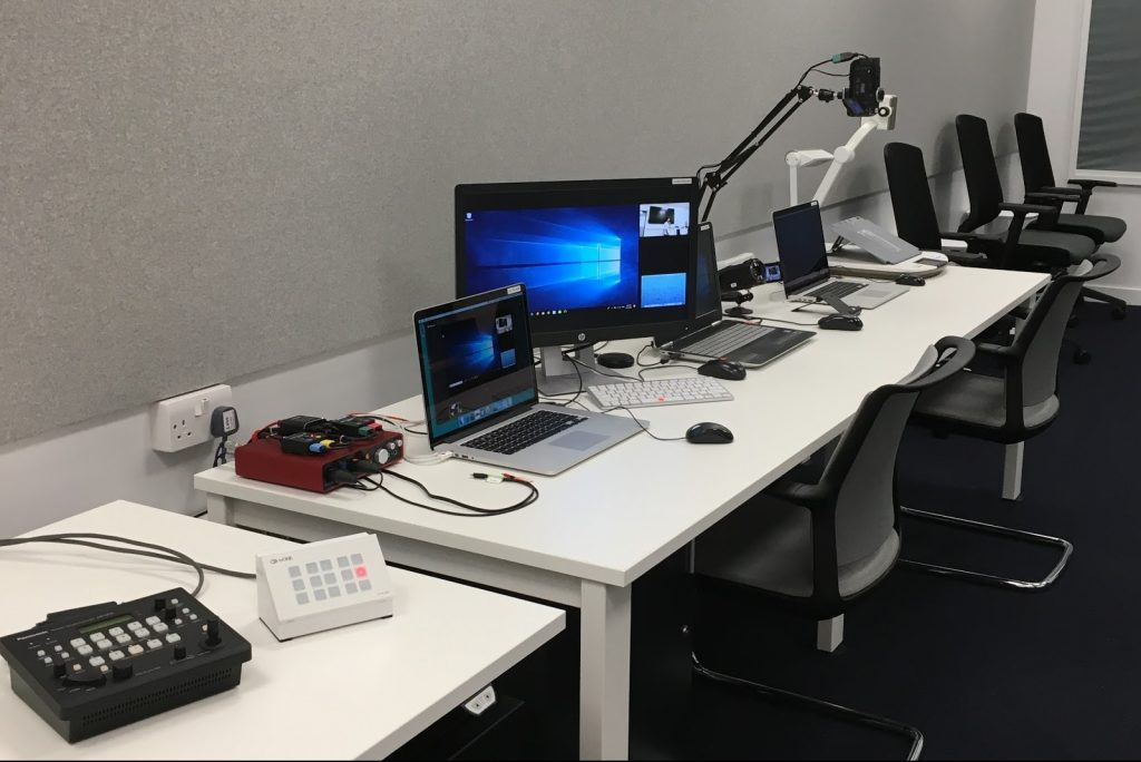 Desks with equipment in the London research lab