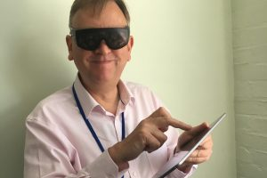Trying goggles that simulate different visual impairments in the London Empathy Lab