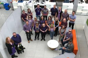 Employees of Newcastle wearing purple