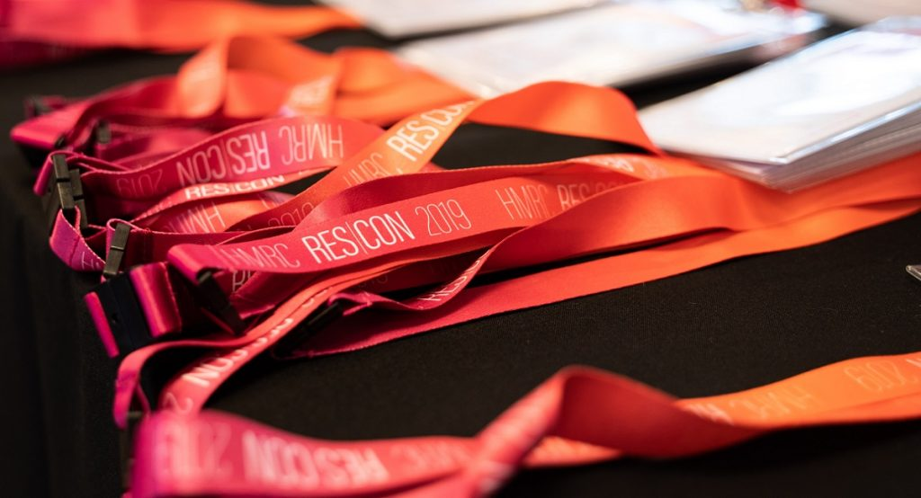 Image of the red lanyards used at the conference