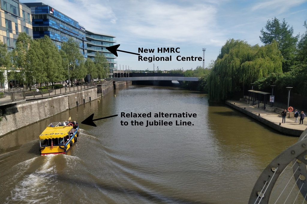 An external view of the new Bristol Regional Centre showing a ferry on the river