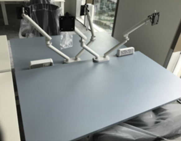Image of grey desks at one of the HMRC regional centres