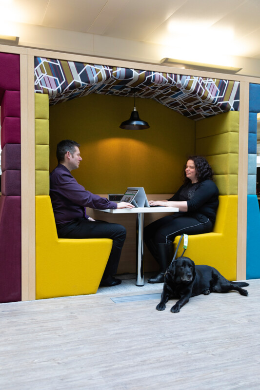 Alt text – HMRC colleagues sat within a breakout area at a Regional Centre